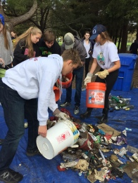 Students sorting trash collected at Kennedy Park